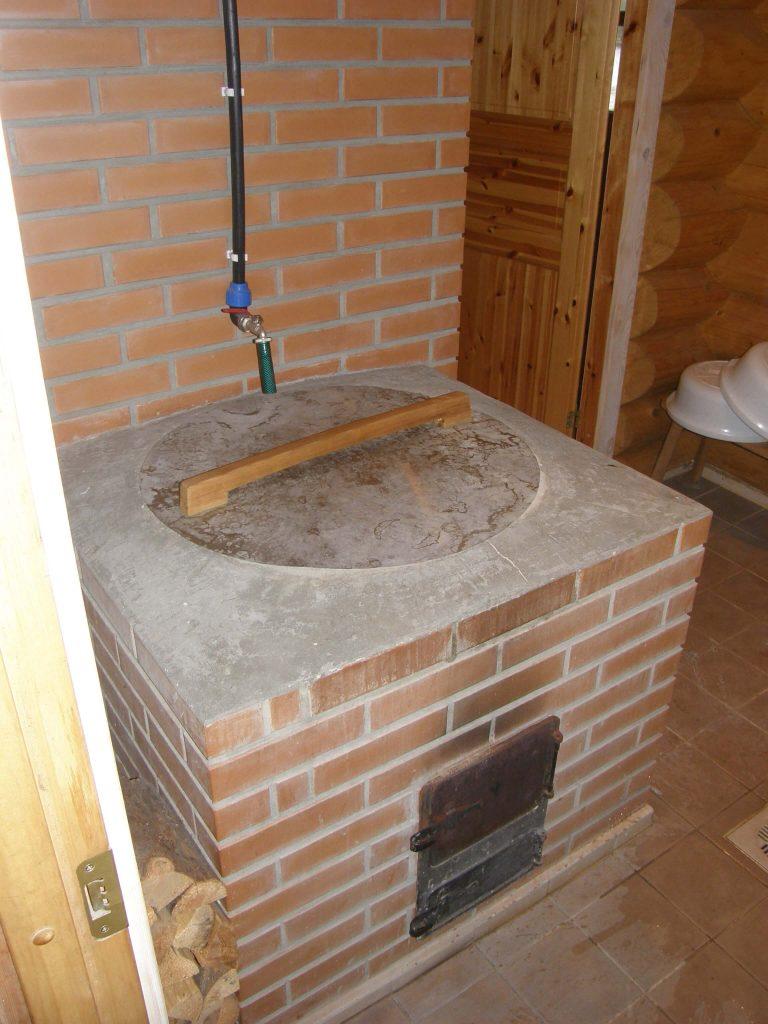 Log sauna with a furnace with a cauldron