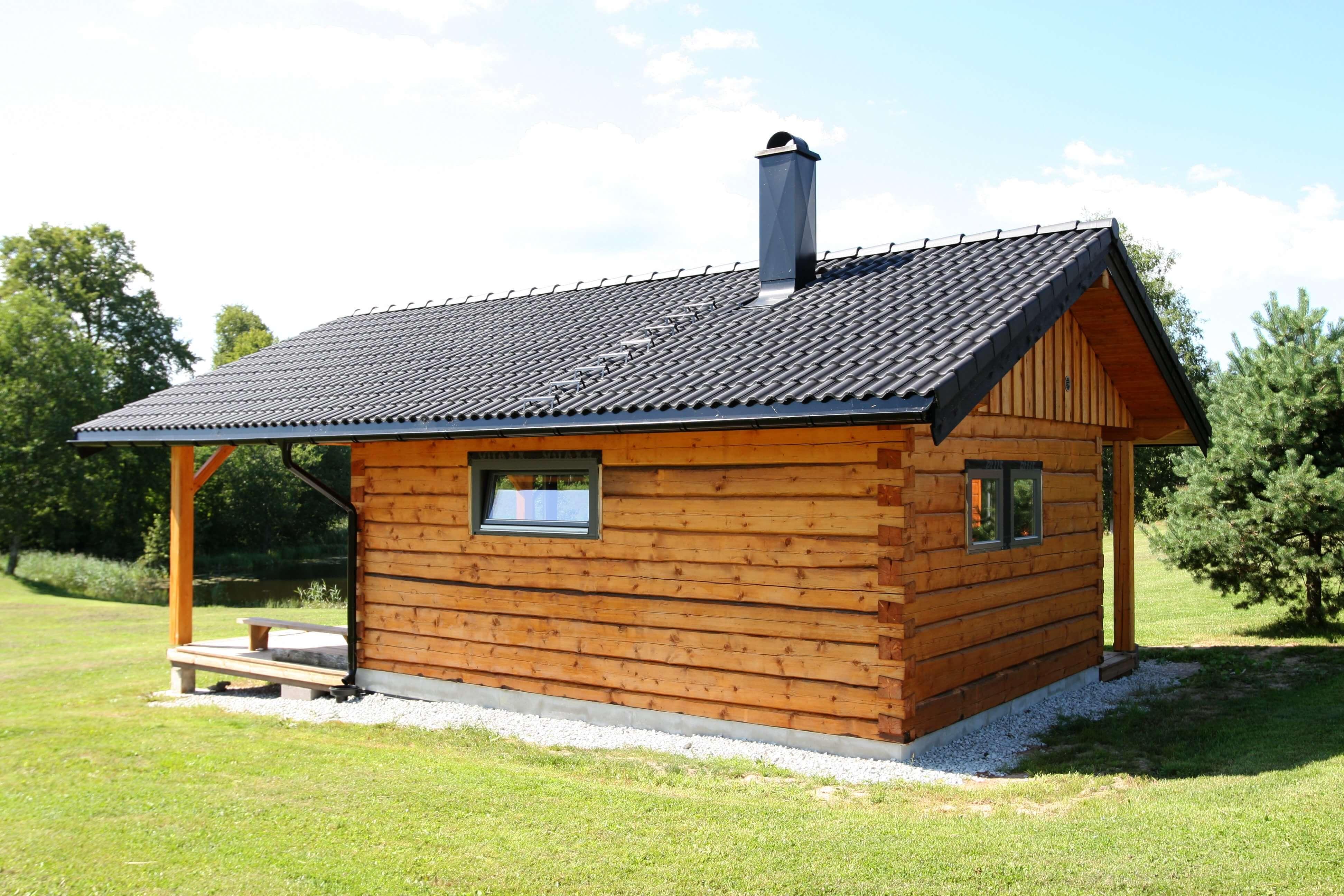 Log sauna with tiled roof