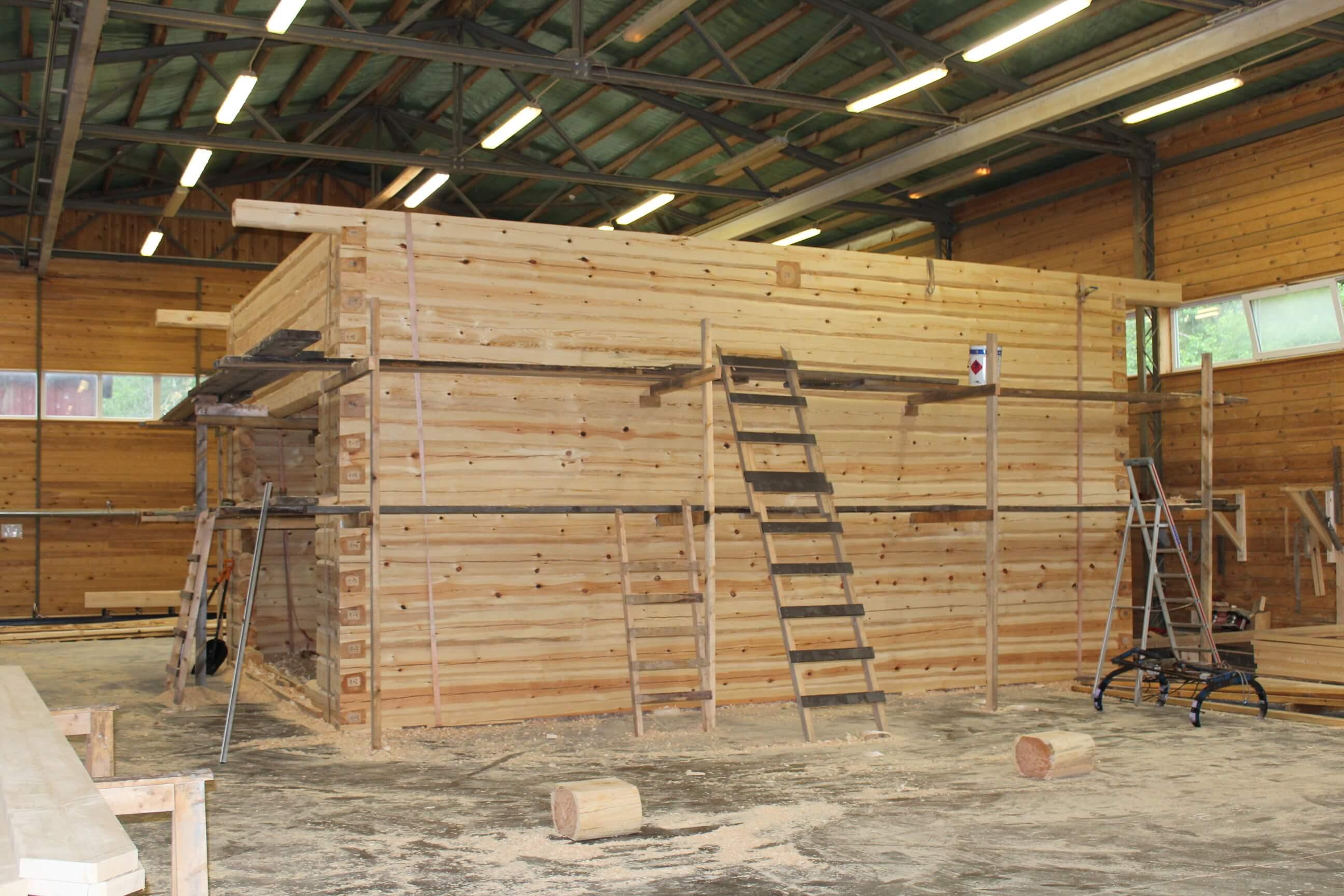 building a log home at tudu factory